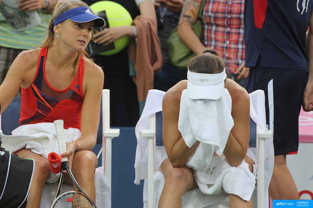 Martin Hingis, Switzerland, reacts after double faulting on her serve to lose the match with partner Daniela Hantuchova, Slovakia, against Sara Errani and Roberta Vinci, ITaly, during the Women's Doubles competition at the US Open. Flushing, New York, USA. 30th August 2013. Photo Tim Clayton