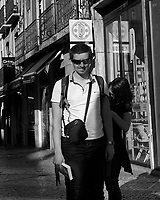 Morning Street Photography in Lisbon. Image taken with a Leica CL camera and 23 mm f/2 lens.
