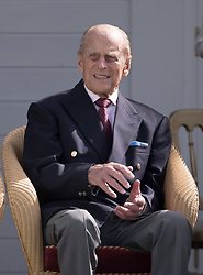 The Duke of Edinburgh watches a British Driving Society parade during the Bentley Motors Royal Windsor Cup Final at Guards Polo Club, Windsor Great Park, Egham, Berkshire.