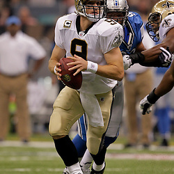2009 September 13: New Orleans Saints quarterback Drew Brees (9) looks to pass during a 45-27 win by the New Orleans Saints over the Detroit Lions at the Louisiana Superdome in New Orleans, Louisiana.