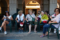 Locals wait in the shade to see the riders speed by at Giro Rosa 2018 - Stage 1, a 15.5 km team time trial in Verbania, Italy on July 6, 2018. Photo by Sean Robinson/velofocus.com