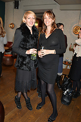 Left to right, ISABELLA McPHERSON and LADY LOUISE FITZROY at a ladies lunch hosted by Thomasina Miers was held at her restaurant Wahaca, 19-23 Charlotte Street, London W1 on 10th January 2014.