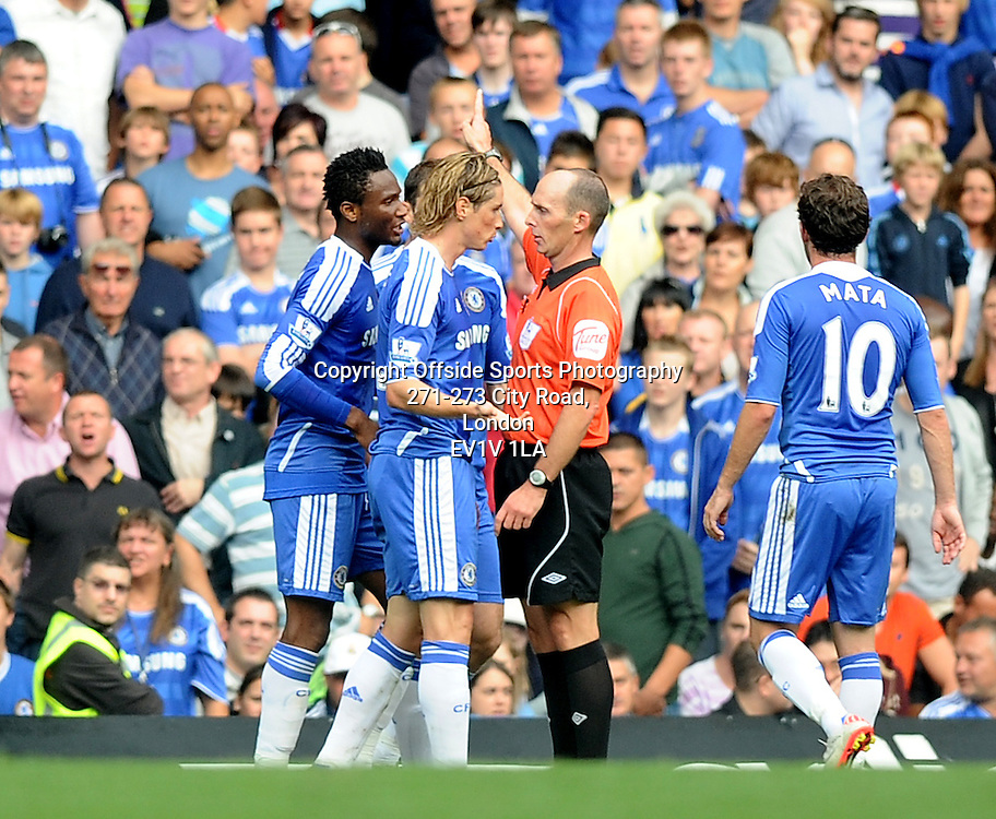 24/09/2011 - Barclays Premier League Football - Chelsea v Swansea City - Chelsea's Fernando Torres is sent off by referee Mike Dean after a bad tackle. - Photo: Charlie Crowhurst / Offside.