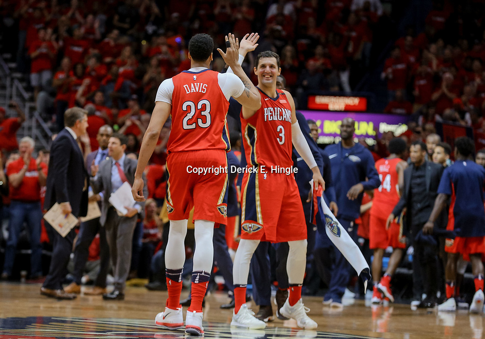 Apr 19, 2018; New Orleans, LA, USA; New Orleans Pelicans forward Anthony Davis (23) celebrates with forward Nikola Mirotic (3) during the second quarter in game three of the first round of the 2018 NBA Playoffs against the Portland Trail Blazers at the Smoothie King Center. Mandatory Credit: Derick E. Hingle-USA TODAY Sports