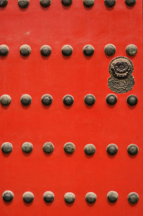 One of the many doors inside the Forbidden City that has been refurbished and freshly painted.