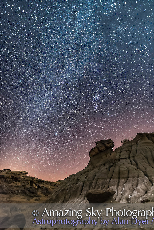 Orion and the winter stars over the badlands of Dinosaur Provincial Park, in southern Alberta, on a very clear (and rare!) clear night, February 28, 2017. Recent warm weather got rid of most of the snow. So the foreground doesn&rsquo;t look too wintery! <br /> <br /> Orion is at centre, Canis Major (with Sirius) below left, and Taurus (with Aldebaran) at upper right. The Milky Way runs down to the south. The clusters M41, M46 and M47 are visible and the Orion Nebula, M42.<br /> <br /> This is a stack of 8 x 30-second exposures for the ground, mean combined to smooth noise, plus one 30-second exposure for the sky. All at f/2.2 with the Sigma 20mm Art lens and Nikon D750 at ISO 6400.