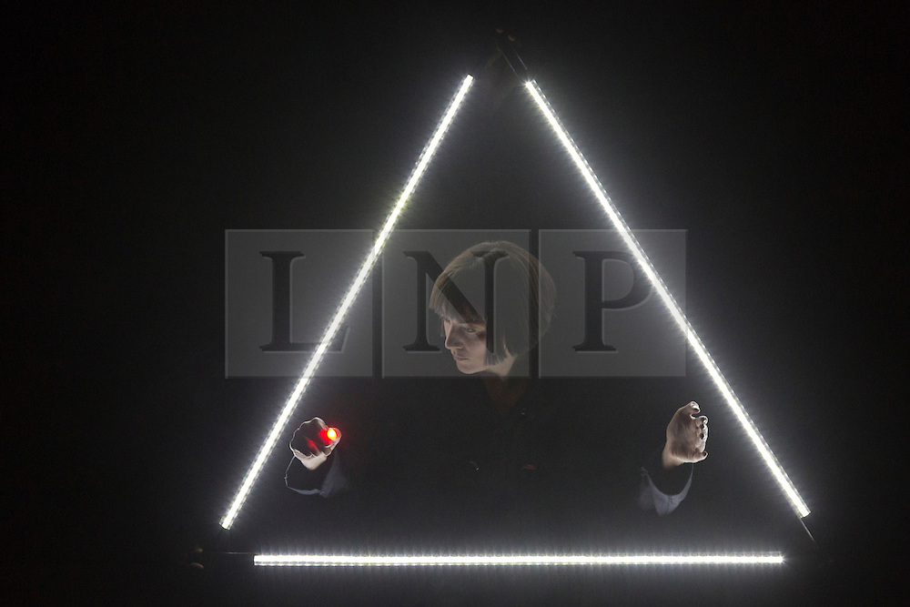 """© Licensed to London News Pictures. 20/01/2015. London, England. Pictured: Deborah Pugh performing. Theatre Ad Infinitum present their show """"Light"""" at the Pit Theatre, Barbican Centre, London, UK. The show is part of the London International Mime Festival (LIMF) and runs from 20-24 January 2015. """"Light"""" is written and directed by George Mann with Charlotte Dubery, Matthew Gurney, Robin Guiver, Deborah Pugh and Michael Sharman performing. Photo credit: Bettina Strenske/LNP"""
