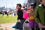 Children line up before the 21st Annual Easter Egg Hunt at Winnequah Park in Monona, WI on Saturday, April 20, 2019.