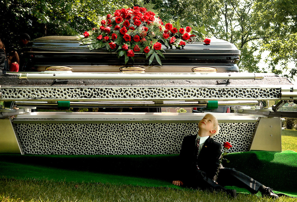 Nicholas Falwell, son of Jonathan Falwell and grandson of the Rev. Jerry Falwell sits under the casket belonging to his grandfather at the burial site at the Carter Glass Mansion on Tuesday, May 22, 2007 a week after the Rev. Jerry Falwell died in Lynchburg, Va.