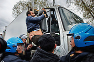 ITALY, GIUGLIANO : Riot police try to block a demonstrator that tries to stop a waste lorry truck outside the Taverna del Re dump in Giugliano on November 2, 2010. Demonstrators protest against the re-opening of the Taverna del Re dump taht contains more than six milion tons of garbage. AFP PHOTO / ROBERTO SALOMONE
