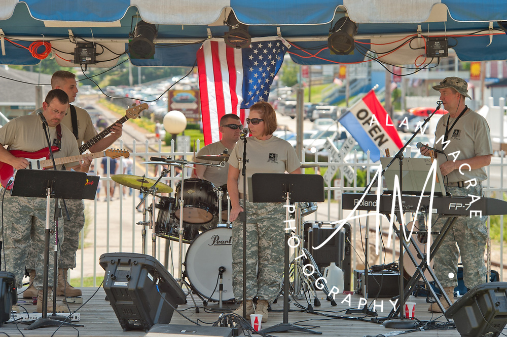 "The 195th Maine Army National Guard Rock Band ""Five Star"" performs at Winnipesaukee Marketplace on Saturday, July 3, 2010.  (Alan MacRae/for the Citizen)"