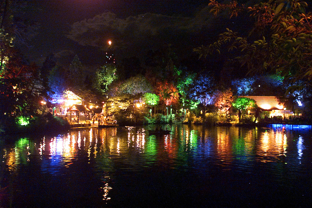 Colourful lights illuminate the trees and reflect in Pukekura Park Lake as part of the annual New Plymouth Festival of the Lights which runs over the Christmas, New Year period, New Zealand, December 27, 2005. Credit:SNPA / Rob Tucker