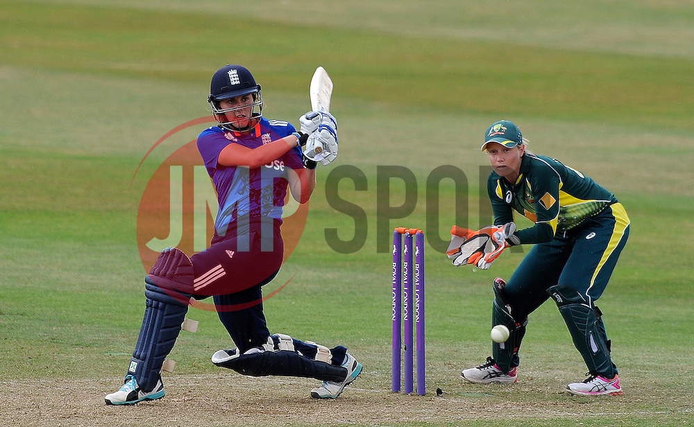 England's Natalie Sciver flicks the ball as Australia's Ellyse Healy looks on- Photo mandatory by-line: Harry Trump/JMP - Mobile: 07966 386802 - 21/07/15 - SPORT - CRICKET - Women's Ashes - Royal London ODI - England Women v Australia Women - The County Ground, Taunton, England.