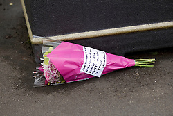 © Licensed to London News Pictures. 27/06/2012. Oldham , UK . A large explosion , believed to be caused by gas , has brought down at least one house in an Oldham terrace . A single bunch of flowers left near to the scene . Photo credit : Joel Goodman/LNP