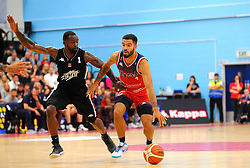 Lewis Champion of Bristol Flyers gets past Samuel Toluwase of London Lions- Photo mandatory by-line: Nizaam Jones/JMP - 19/10/2019 - BASKETBALL - SGS Wise Arena - Bristol, England - Bristol Flyers v London Lions - British Basketball League Cup