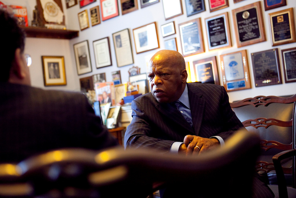 Rep. John Lewis (D-GA), right, sits for an interview in his office on Capitol Hill with Hiroki Sugita of the Kyodo News Agency on Tuesday, Apr. 21, 2009 in Washington, DC.