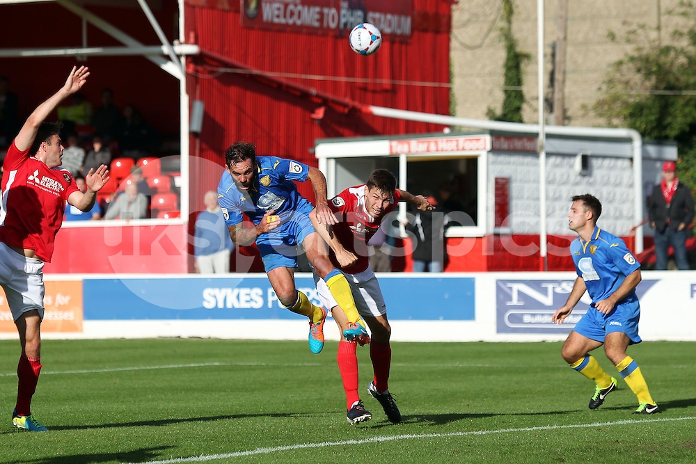 Basingstoke's Jamie Brown and Ebbsfleets Charlie Sheringham in action during the FA Cup 3Q match between Ebbsfleet United v Basingstoke Town, Stonebridge Road, Northfleet, Kent DA11 9GN on 11 October 2014. Photo by Ken Sparks.