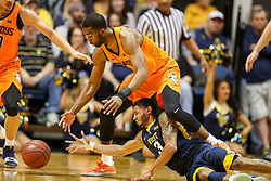 Feb 10, 2018; Morgantown, WV, USA; Oklahoma State Cowboys guard Tavarius Shine (5) and West Virginia Mountaineers guard James Bolden (3) dive for a loose ball during the first half at WVU Coliseum. Mandatory Credit: Ben Queen-USA TODAY Sports
