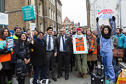 © Licensed to London News Pictures. 12/01/2016. London, UK.  Johann Malawana, Chair of the British Medical Association (BMA) listens to speeches by to junior doctors and supporters at the picket outside the Royal London Hospital in Whitechapel, east London. Junior doctors across England are taking strike action today after talks failed between the British Medical Association (BMA), NHS bosses and Health secretary, Jeremy Hunt regarding a new contract, weekend pay and working hours. Photo credit : Vickie Flores/LNP