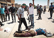 Following an attack on Tawergha, fighters from Misrata cornered two Gadhafi's soldiers during a house to house search. After a short stand off, grenades were ultimately thrown killing the two loyalists. Rebels pushed into the outskirts of the small town, south east of Misrata, in an attempt to expand their controlled zone around the city and keeping it out of range from Grad rockets. Later in the day, they withdraw out of Tawargha in fear of being encircled by superior forces. 16 May 2011.