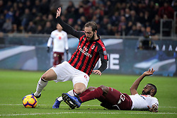 December 9, 2018 - Milan, Milan, Italy - Gonzalo Higuain #9 of AC Milan competes for the ball with Nicolas Nkoulou #33 of Torino FC during the serie A match between AC Milan and Torino FC at Stadio Giuseppe Meazza on December 09, 2018 in Milan, Italy. (Credit Image: © Giuseppe Cottini/NurPhoto via ZUMA Press)