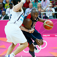 06 August 2012: USA Kobe Bryant drives past Argentina Facundo Campazzo during 126-97 Team USA victory over Team Argentina, during the men's basketball preliminary, at the Basketball Arena, in London, Great Britain.
