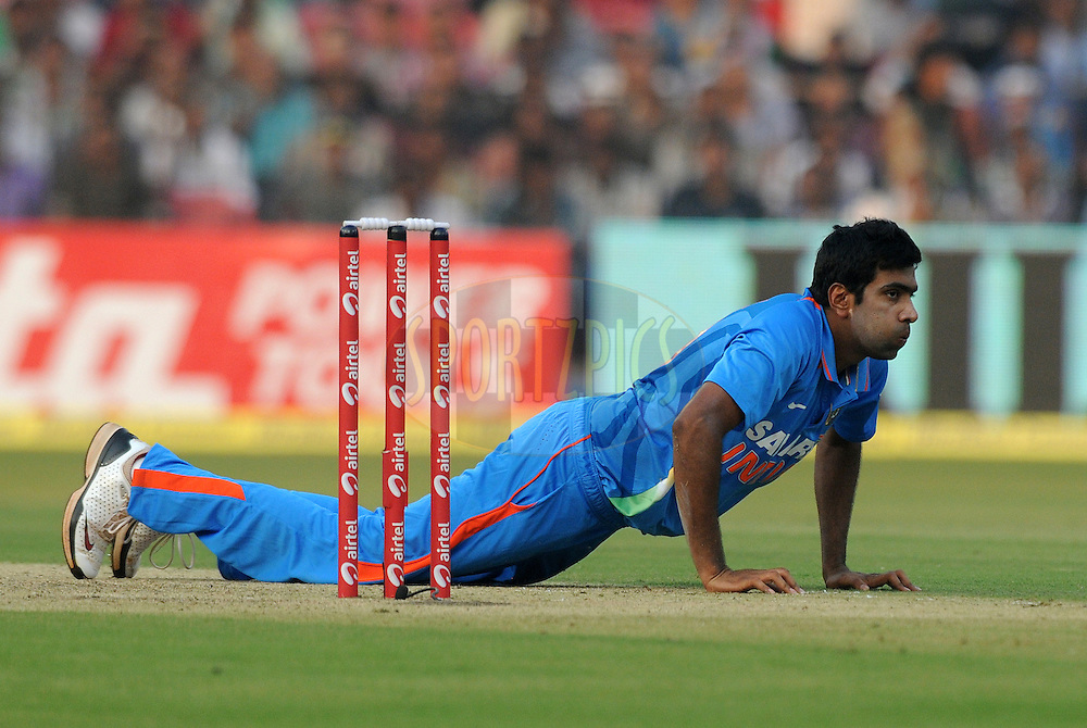 Ravichandran Ashwin of India tries to stop a ball during the 1st ODI ( One Day International ) match between India and The West Indies held at The Barabati Stadium in Cuttack, India on the 29th November 2011..Photo by Pal Pillai/BCCI/SPORTZPICS