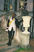 Man in historical fancy dress costume posing on the outside staircase, Posh at Addington Palace, UK, August, 2004