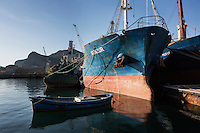 """PALERMO, ITALY - 6 JUNE 2016: (L-R) Fishing boat Ozu 2 and cargo ships Munzur and Meryem, seized respectively in July 2015 with 5 tons of hashish, in December 2015 with 13 tons of hashish and in  June 2015 with 12 tons of hashish within the """"Operazione Libeccio"""", are docked here in the harbor of Palermo, Italy, on June 6th 2016.<br /> <br /> Between January 2014 e December 2015 more than 120 tons of hashish, carried on fishing boats or cargo ships from Morocco to Libya, were seized in the Strait of Sicily by Italy's Guardia di Finanza (Financial Police) thanks to an international police investigation named """"Operazione Libeccio"""", carried out by the GICO (Gruppo Investigativo Criminalità Organizzata, Organised Crime Investigation Group), a unit of the tax police of Palermo under the supervision of the DDA (Direzione Distrettuale Antimafia) of Palermo.<br /> <br /> """"What is happening in Libya is same historical occurrence that happened years ago in Afghanistan. Such as the Talibans who financed their terroristic activities with heroin trafficking for the purchase of weapons, the Caliphate is proposing the same terroristic strategy by purchasing and commercialising hashish in order to purchase weapons used in their war"""" Sergio Barbera, Deputy General Prosecutor of Palermo, said."""