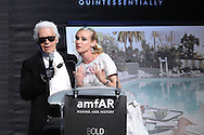 ANTIBES, FRANCE - MAY 24:  Karl Lagerfeld and Diane Kruger attend amfAR's Cinema Against AIDS auction at Hotel Du Cap on May 24, 2012 in Antibes, France.  (Photo by Tony Barson/FilmMagic)