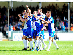 Bristol Rovers' Ollie Clarke (L) is joined by his team mates to celebrate his goal - Photo mandatory by-line: Neil Brookman - Mobile: 07966 386802 23/08/2014 - SPORT - FOOTBALL - Bristol - Memorial Stadium - Bristol Rovers v AFC Telford - Vanarama Football Conference