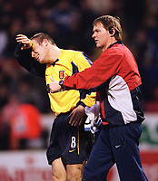 Injured Fredrik Ljungberg is treated by Arsenal physio Gary Lewin. Chartlon Athletic 1:0 Arsenal, FA Carling Premiership, 1/1/2001. Credit Colorsport / Stuart MacFarlane.