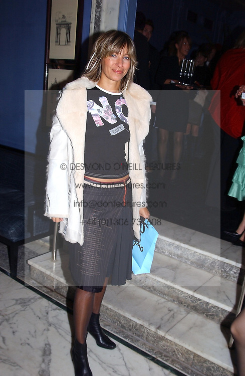 MAYA FIENNES at a party to celebrate the launch of Michelle Watches held at the Blue Bar, The Berkeley Hotel, London on 7th October 2004.<br />