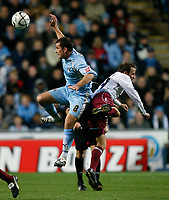 Photo: Steve Bond.<br /> Coventry City v West Ham United. Carling Cup. 30/10/2007. Michael Doyle (L) and Lee Bowyer (R) contest a high ball