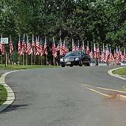 Memorial Day celebrated in small town America. Clifton, New Jersey, USA. Each Memorial Day, Flag Day, Fourth of July, 9/11 Commeration and Veterans Day, the city erects a flag for each living or deceased veteran. The flags currently number 1,348. Each flag has a plaque with the Vereran's name.