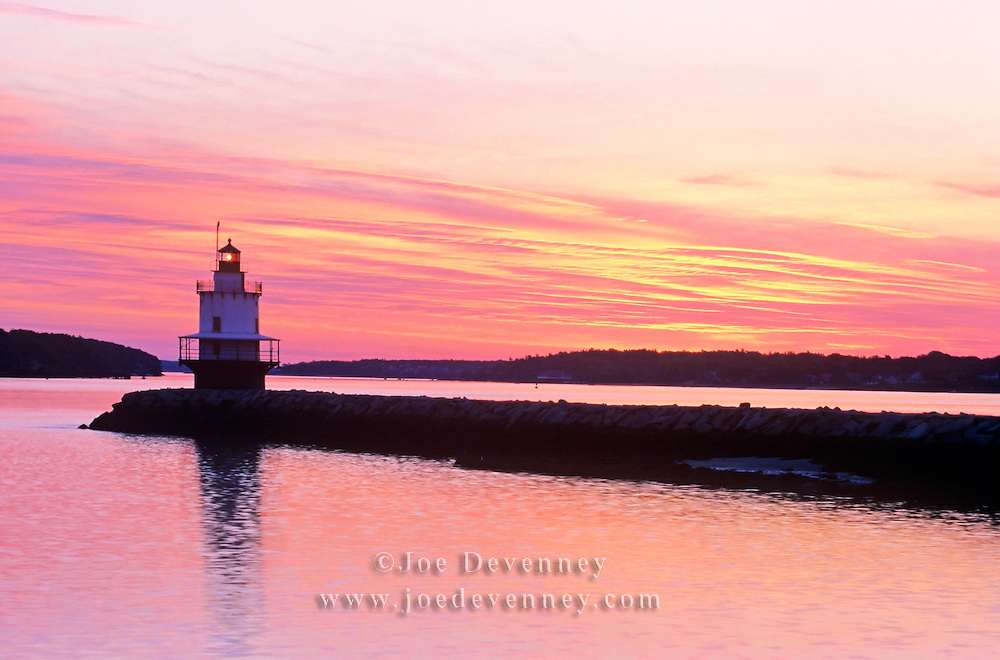 Spring Point Lighthouse and breakwater at sunrise. South Portland, Maine