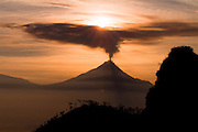 Mount Merapi, near Yogyakarta, Indonesia, simmers at sunrise on 26 May 2006, 24 hours preceding a Richter scale 5.9 earthquake centered  in the Indian Ocean some 60 kilometers south. The quake left at least 3,000 dead, many thousands more wounded and tens of thousands homeless.