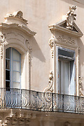 Goose breast ironwork balcony of Palazzo Rau Della Ferla in Noto city, Sicily, Italy