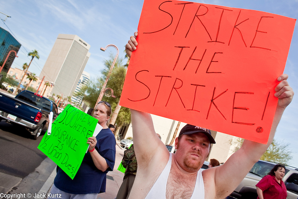 Nov. 9, 2009 -- PHOENIX, AZ: BEN WILSON, who works in a Fry's grocery store in Phoenix, AZ, and is opposed to an expected strike, pickets the offices of UFCW Local 99 in Phoenix Monday. Members of the United Food and Commercial Workers Union (UFCW) Local 99, based in Phoenix, AZ, is expected to go on strike against Fry's and Safeway grocery stores in Arizona on Friday, Nov. 13. The key sticking point in negotiations, which have broken down, is health care. Currently union members get health coverage for free, the grocery chains want to charge $5.00 per month. The stores have started hiring non-union replacement workers In anticipation of the strike. Unemployment in Arizona is around 10 percent and many union members have now come out against a strike fearing they could lose their jobs.    Photo by Jack Kurtz