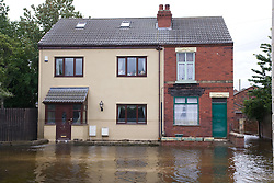 Flooded street and tide marks on a front door after flooding at Toll Bar; South Yorkshire; July 2007,