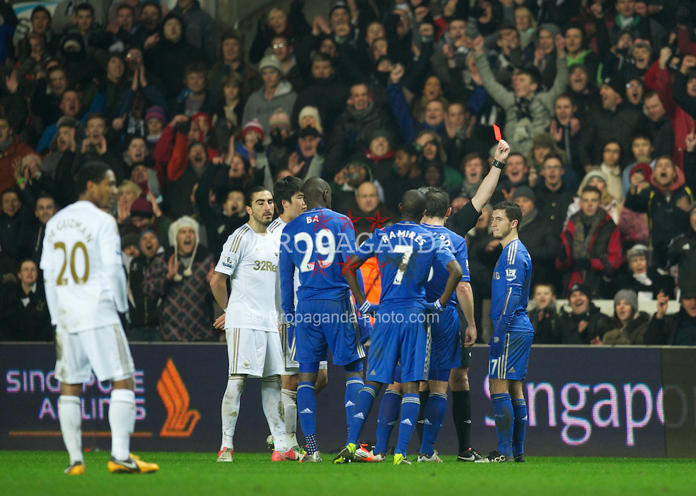 SWANSEA, WALES - Wednesday, January 23, 2013: Chelsea's Eden Hazard is shown the red card after kicking a Swansea City ball-boy during the Football League Cup Semi-Final 2nd Leg match at the Liberty Stadium. (Pic by David Rawcliffe/Propaganda)