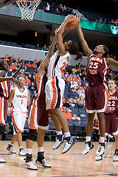 Virginia Tech's Britney Anderson (25) blocks a shot by UVA's Monica Wright (22) in the second half.  The Virginia Tech Hokies overcame a 14 point Virginia lead to beat the Cavaliers 60-58 on their home court at the John Paul Jones Arena in Charlottesville, VA.