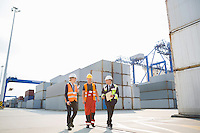 Full-length of workers walking in shipping yard