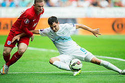 Wayne Rooney of England vs Branko Ilic of Slovenia during the EURO 2016 Qualifier Group E match between Slovenia and England at SRC Stozice on June 14, 2015 in Ljubljana, Slovenia. Photo by Vid Ponikvar / Sportida