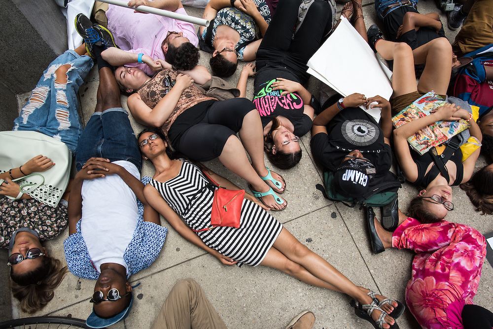 Protestors of police violence stage a die-in at Chicago City Hall on August 17, 2015.
