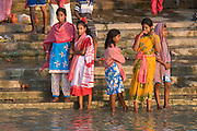 People bathing in shallow water of the Hoogly river. Calcutta. India.
