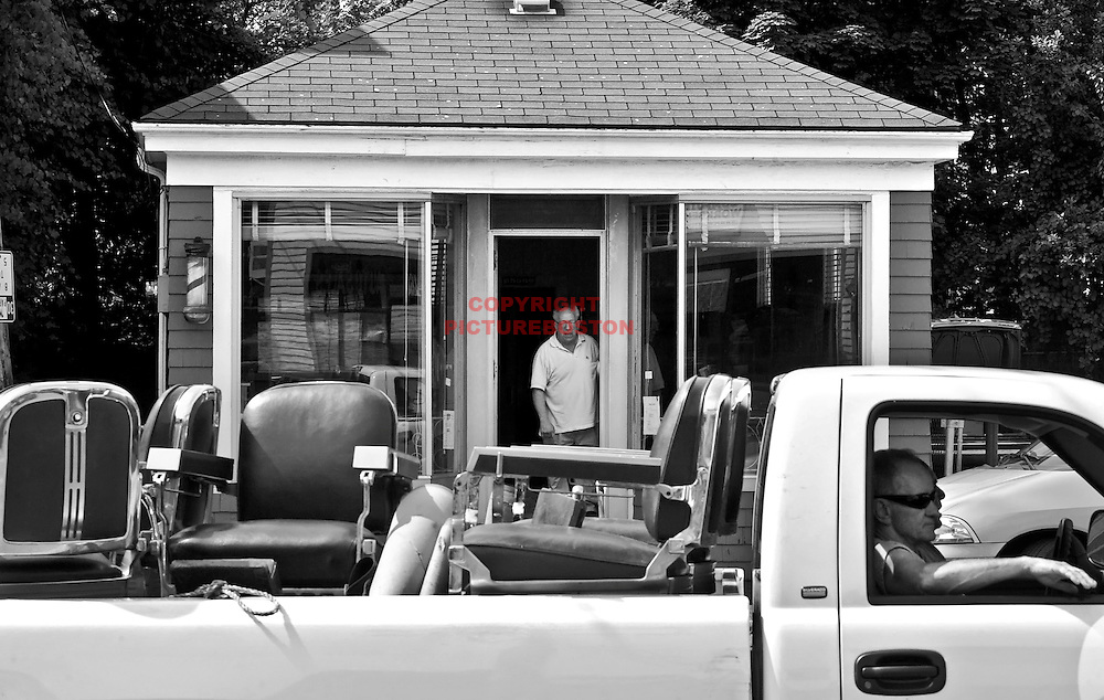 Tony watches as the barber chairs are driven away to a new home, another barbershop, thus ending the business that has been in his family for over 70 years.