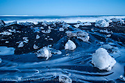 Small icebergs and chunks of ice come ashore along Iceland's eastern coastline