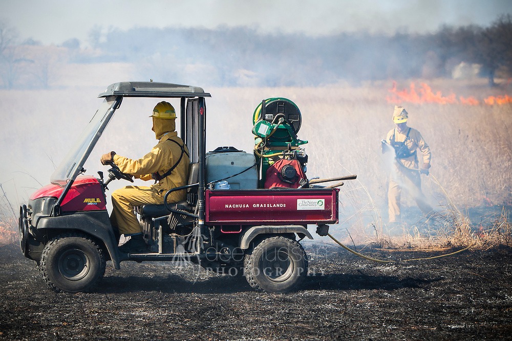 The 'little Mule' ATV carries the portable pump unit and enables the crew to move with the fire.