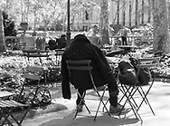 Anonymous man, perhaps homeless, sitting on a chair in Bryant Park